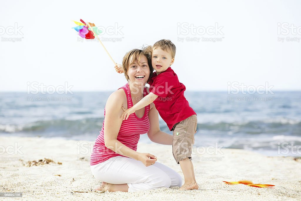 Mother and son having fun on the beach. royalty-free stock photo
