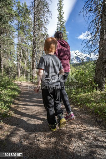 Mother and Son Hiking at Lake Louise Campground close to Bow River, Banff, Alberta, Canada