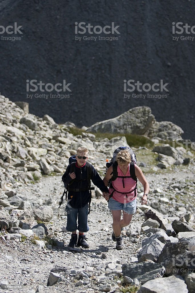 Mother and son hiking in the Italian Alps royalty-free stock photo