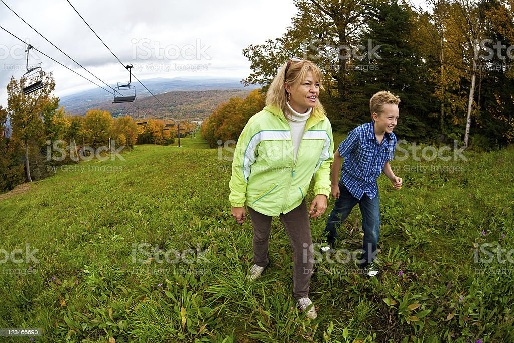 Mother and son hiking on a mountain royalty-free stock photo