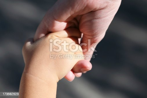 istock Mother and son holding hands 173562523