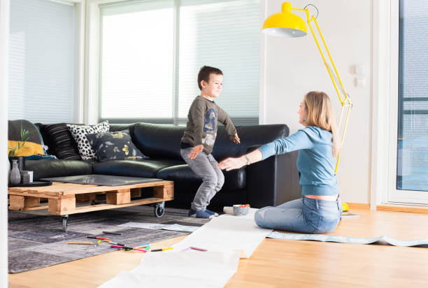 mother and son home alone for weekend - tamara dragovic stock photos and pictures