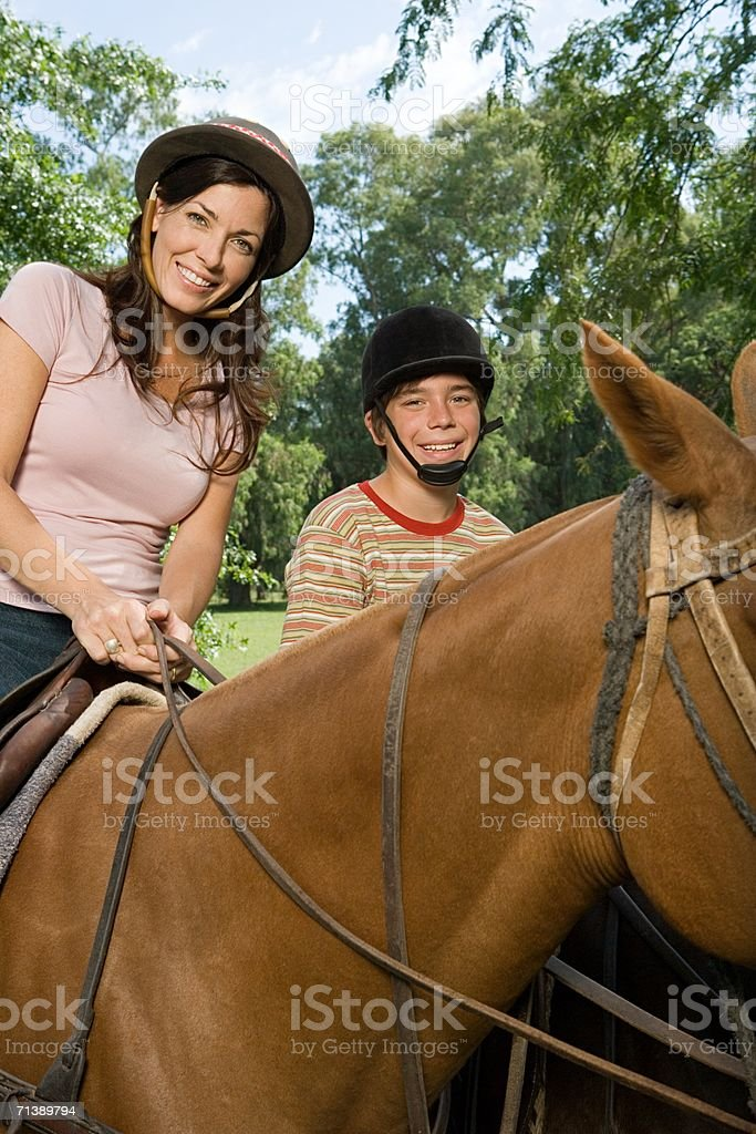 Mother and son horseback riding royalty-free stock photo