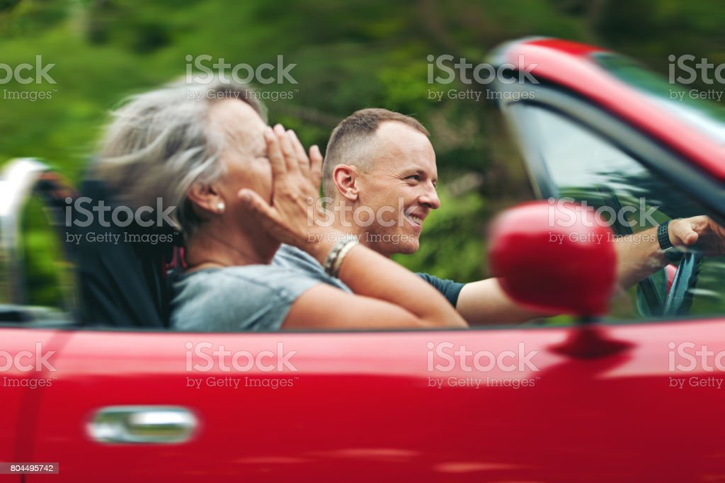 Mother and son in a convertible stock photo