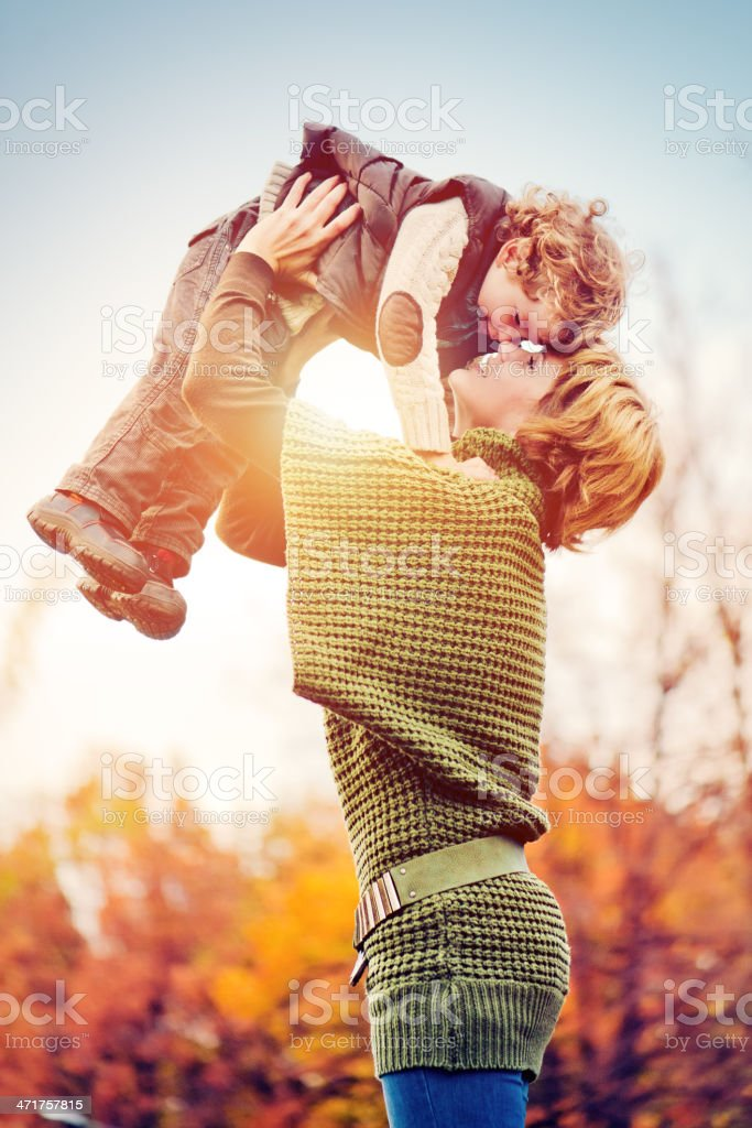 Mother and son in autumn stock photo