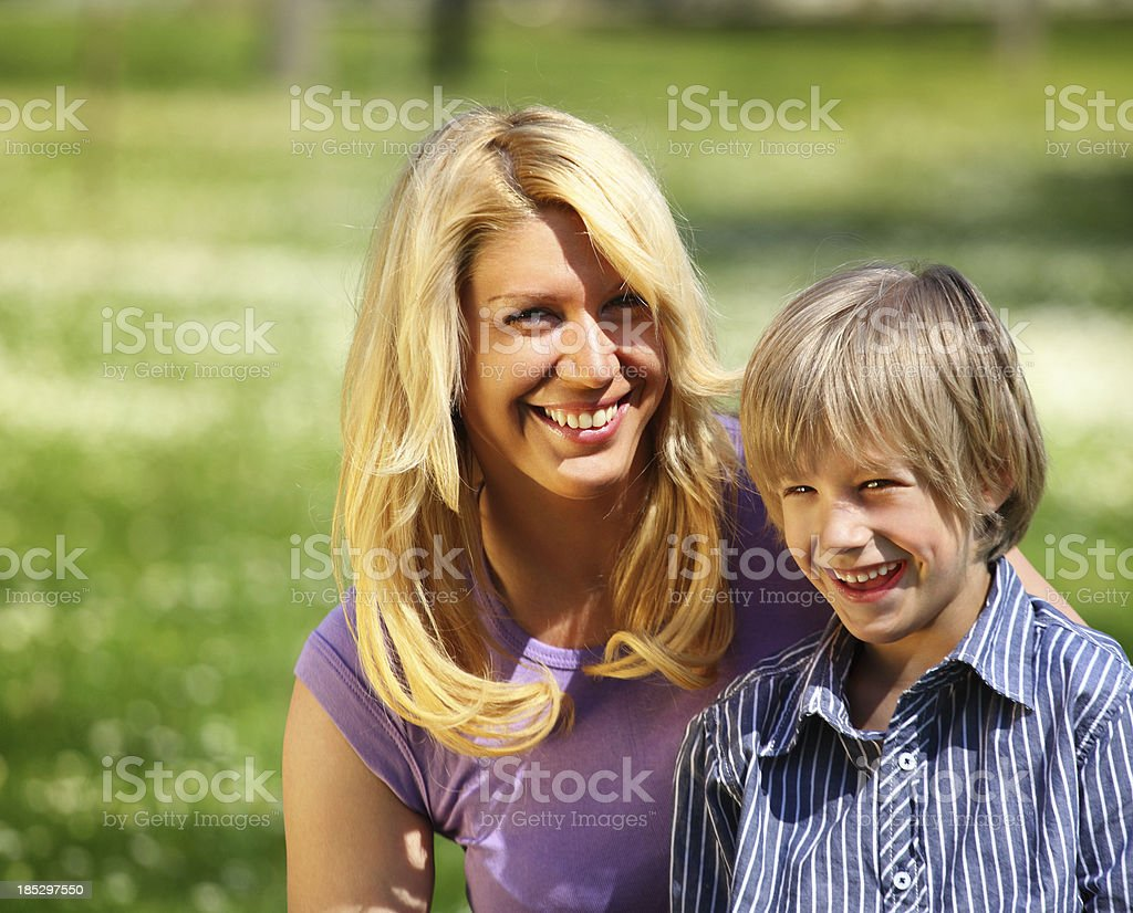 Mother and son in park. stock photo