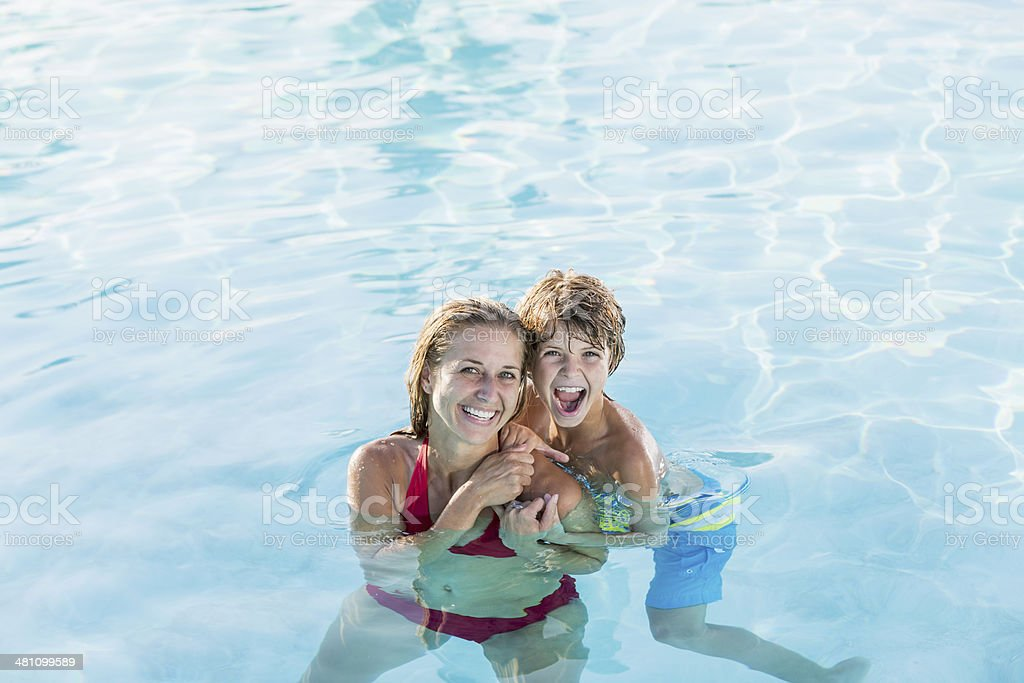 Mother and son in pool stock photo