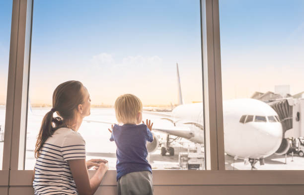 Mother and son in the airport stock photo