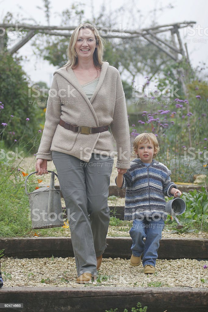 Mother and Son in The Garden royalty-free stock photo