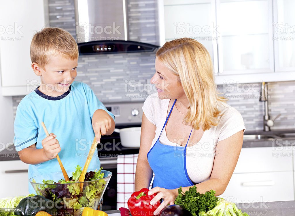 Mother and son  in the kitchen royalty-free stock photo