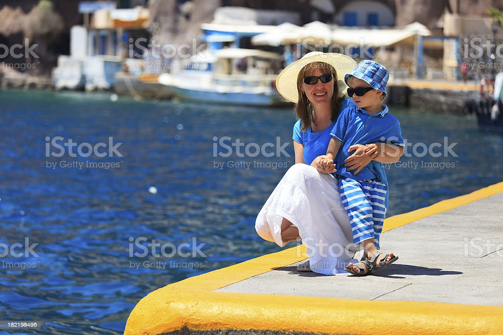 mother and son in the port of Santorini, travel concept royalty-free stock photo