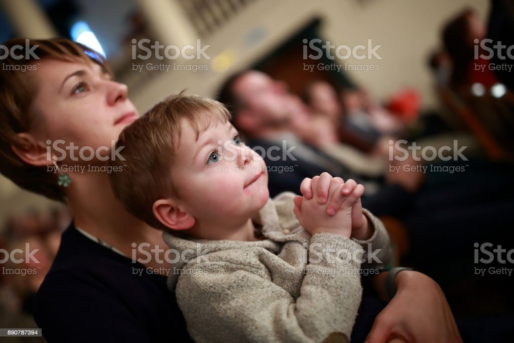 Mother and son in theater stock photo