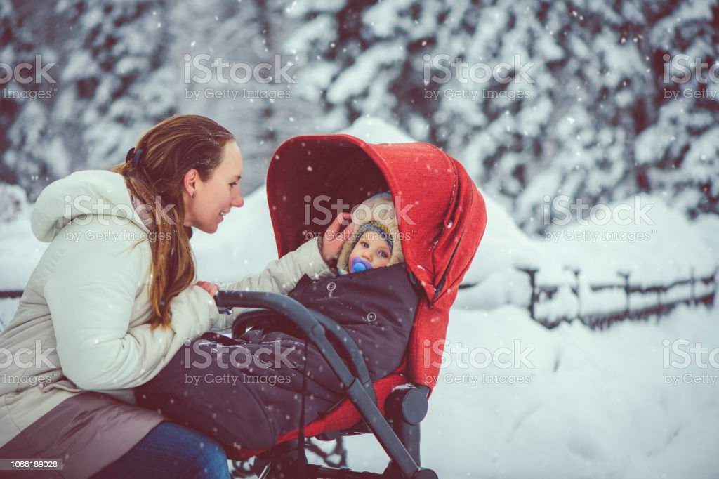 Mother and son in winter park stock photo