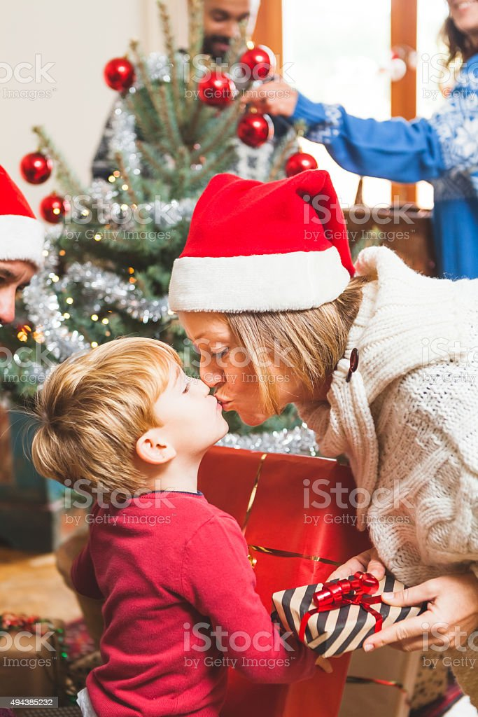 Mother and Son Kissing at Christmas stock photo