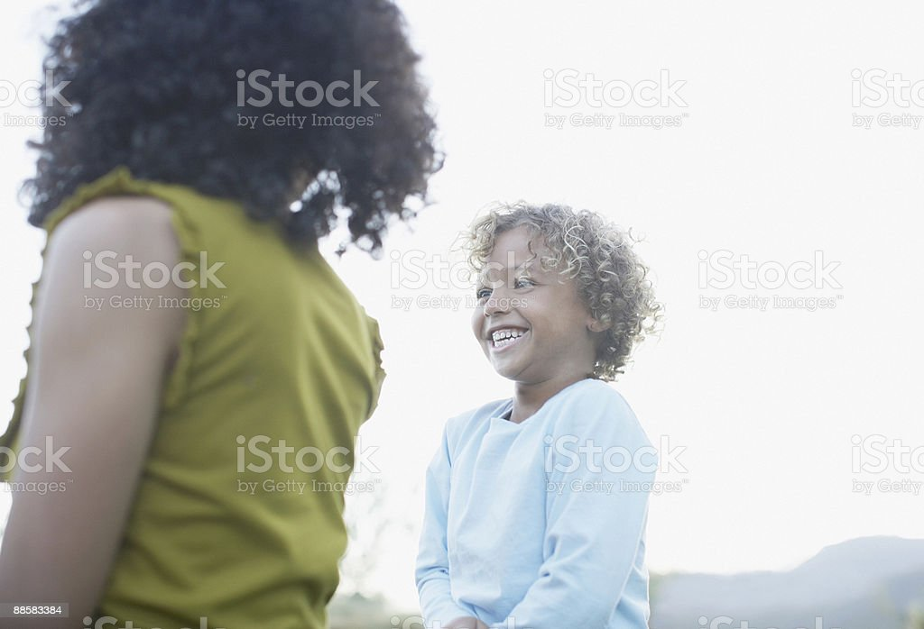 Mother and son laughing outdoors royalty-free stock photo