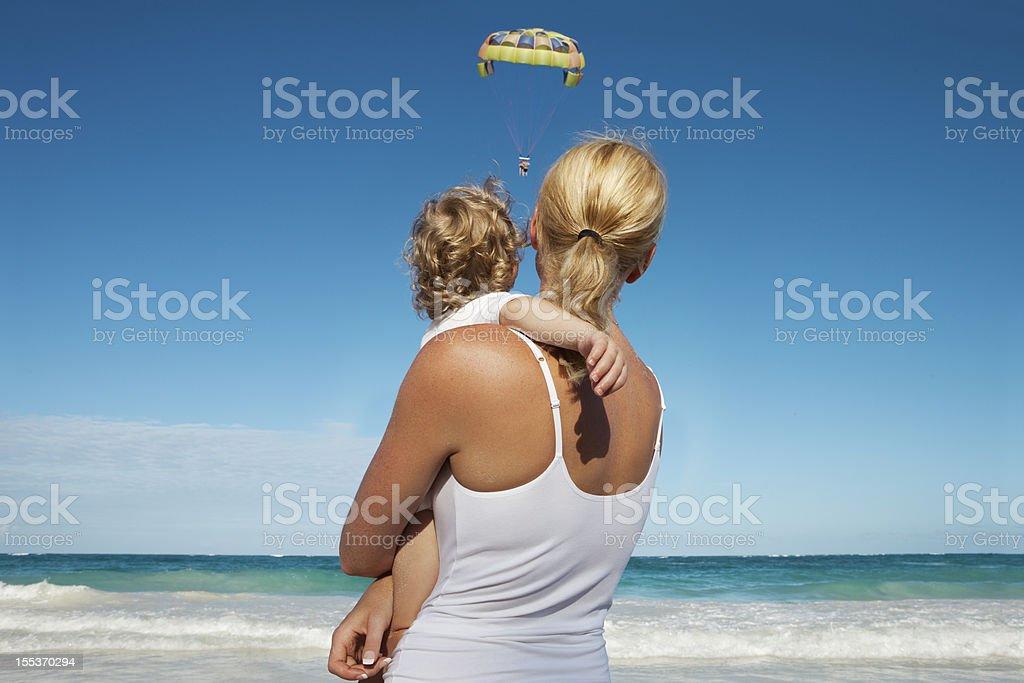 Mother And Son Looking At Parasailing royalty-free stock photo