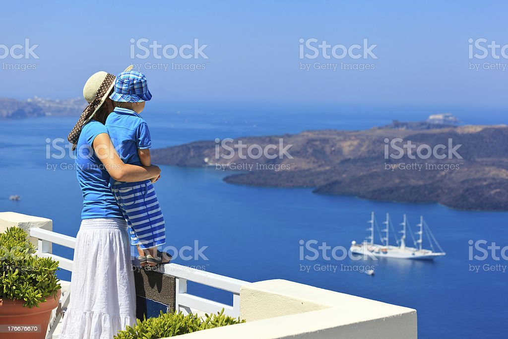 mother and son looking at Santorini, Greece royalty-free stock photo