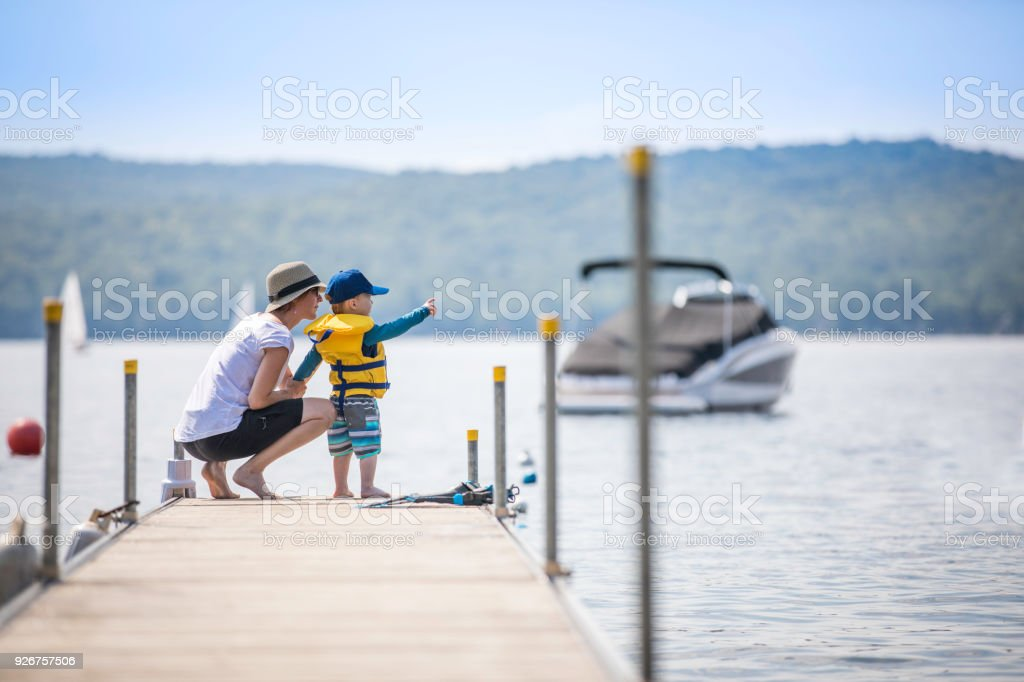 Mother and Son Looking at the View on Pier in Summer stock photo