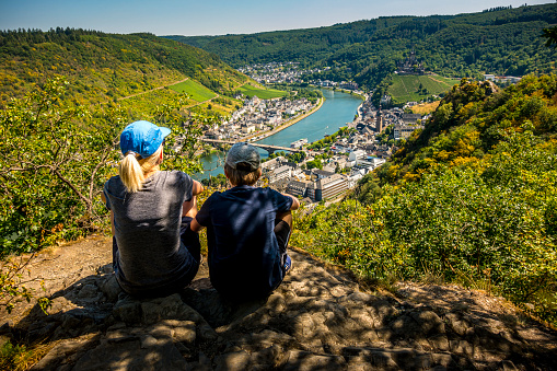 mother and son looking down to Cochem and River Mosel in Germany