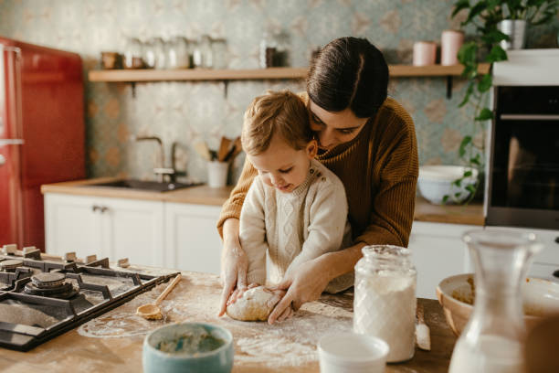 mother and son making cookies - christmas cooking imagens e fotografias de stock
