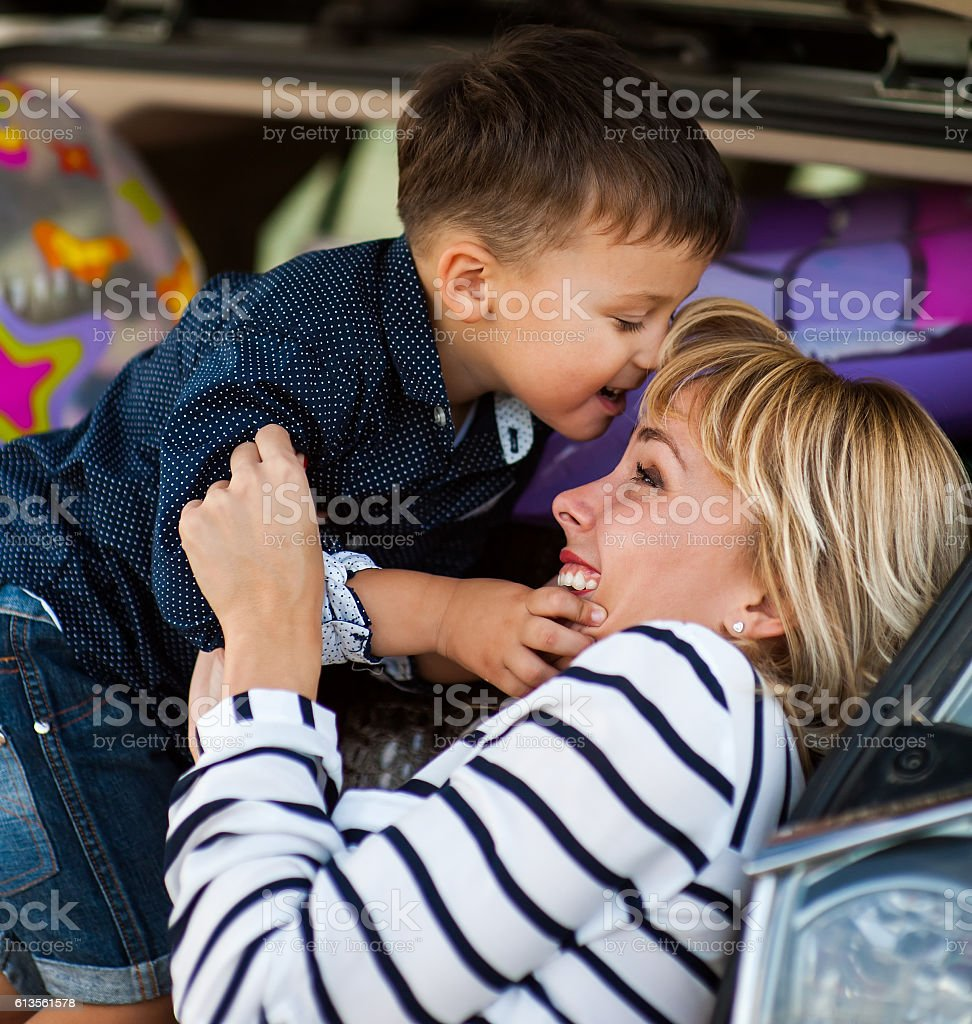 Mother and son near the machine. stock photo