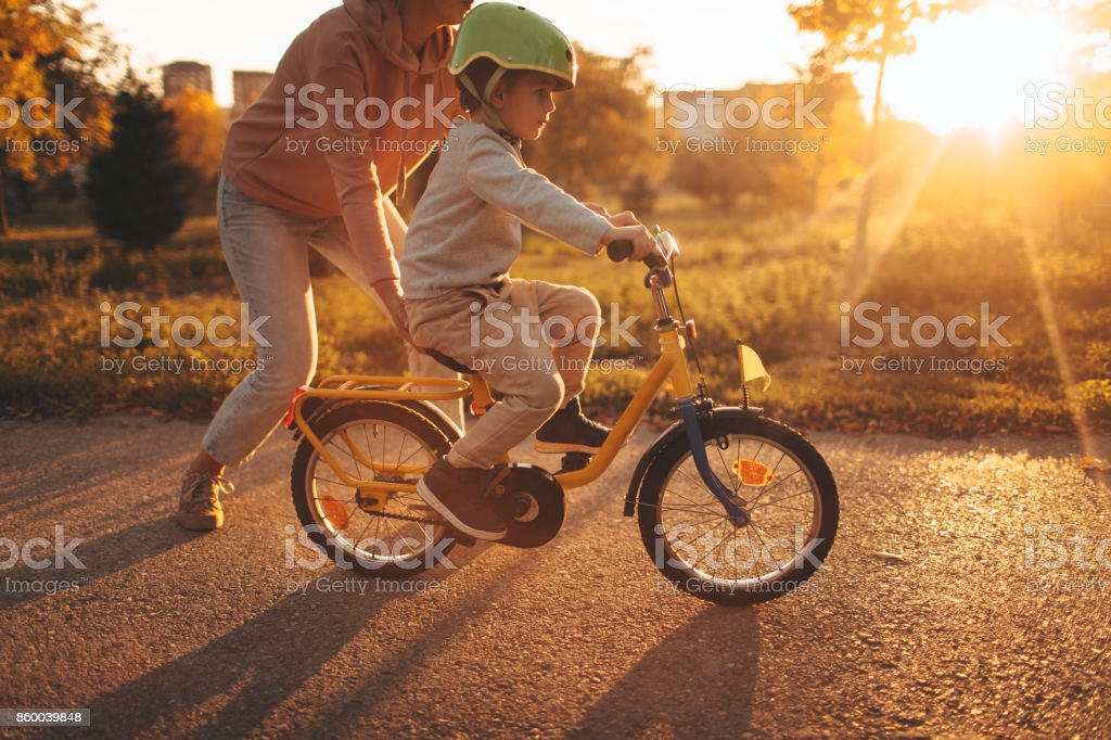 Mother and son on a bicycle lane stock photo