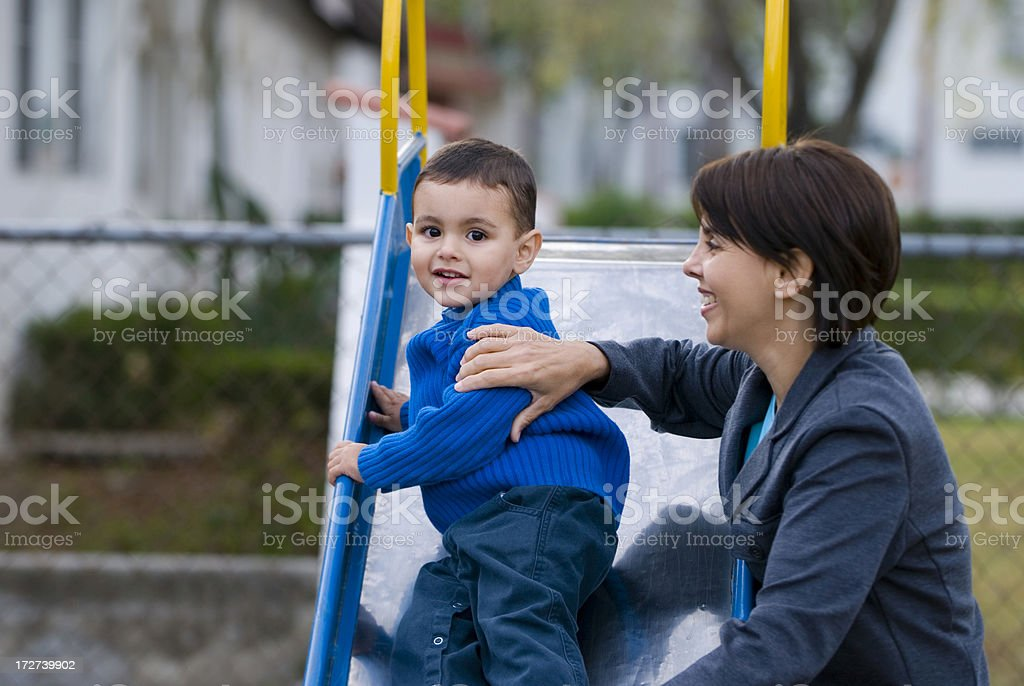 Mother and son on a playground royalty-free stock photo