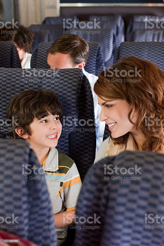 Mother and son on airplane royalty-free stock photo