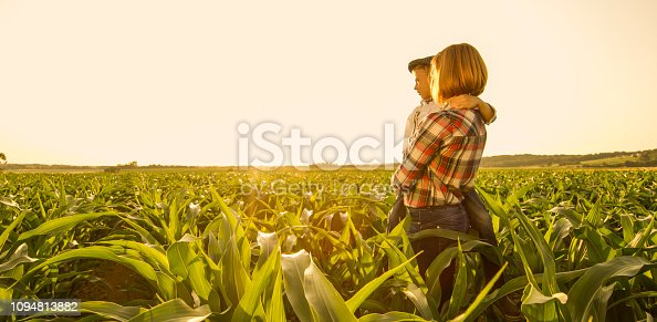 1094815168 istock photo Mother and son on corn field 1094813882