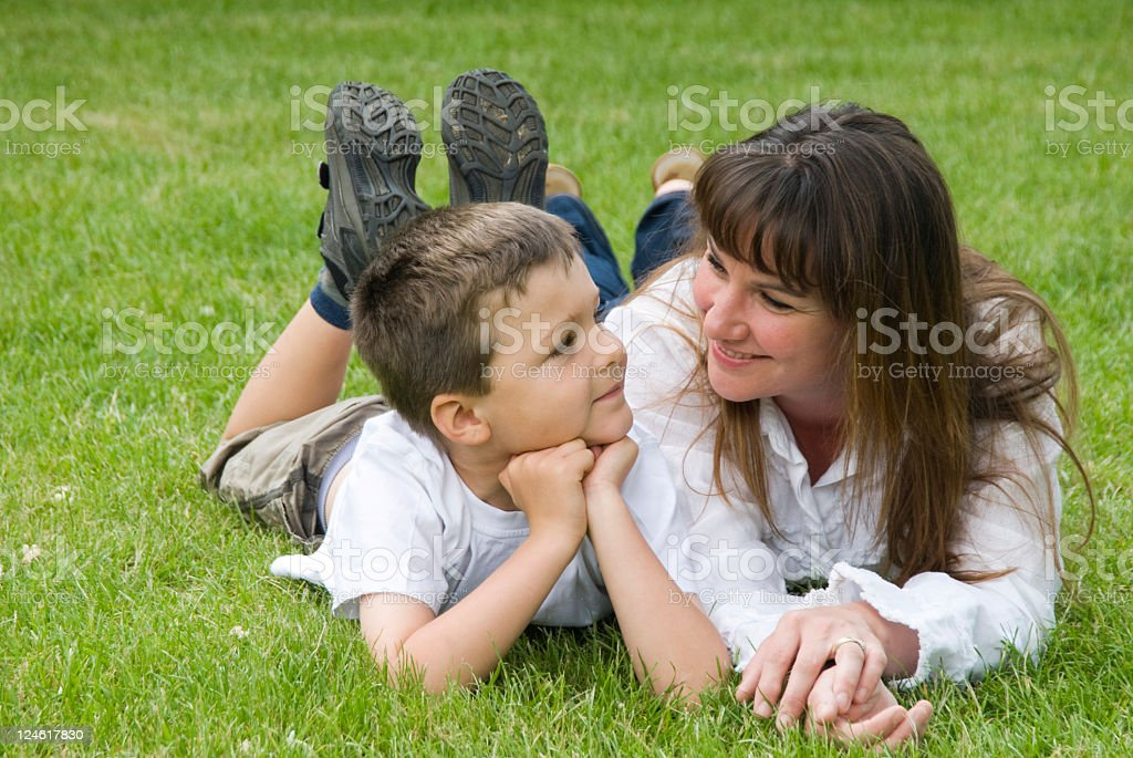 Mother and son on the grass royalty-free stock photo
