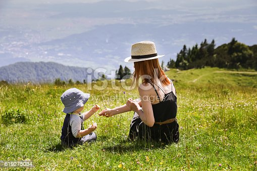 istock Mother and Son on the Nature Background. 619275034