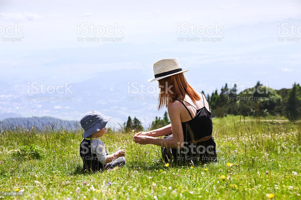 Mother and Son on the Nature Background. stock photo
