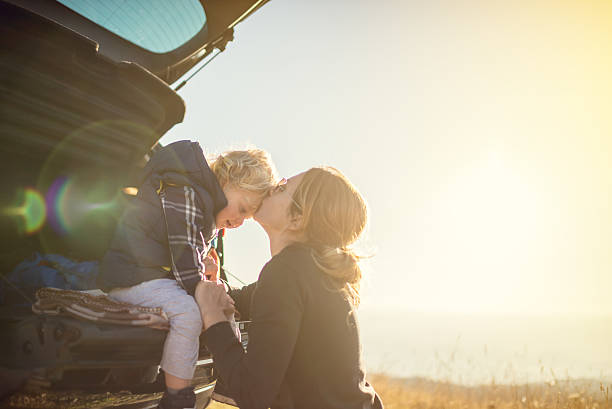 mother and son on the road trip - rural lifestyle stock photos and pictures