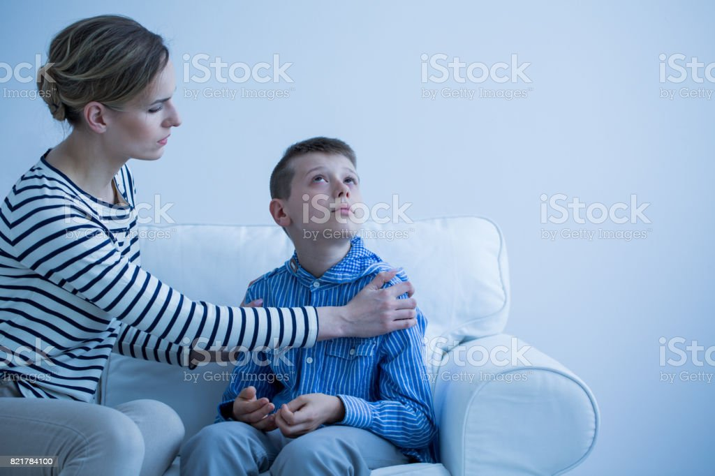 Mother and son on the sofa stock photo