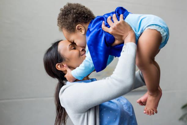 mother and son - baby super hero imagens e fotografias de stock