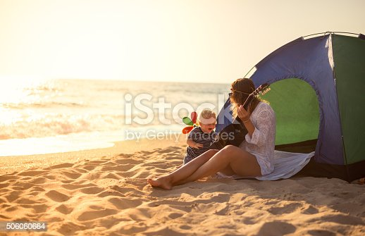 istock Mother and son playing a guitar on the beach 506060664