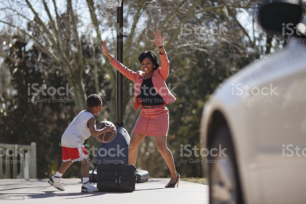 Mother and Son Playing Basketball royalty-free stock photo