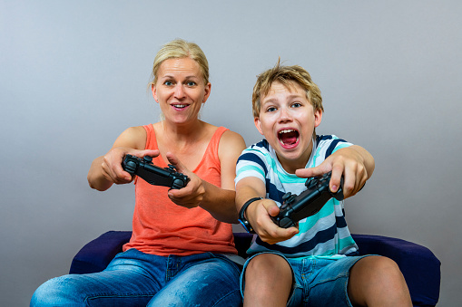 mother and son playing computer games