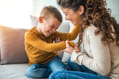istock Mother and son playing in a living room 1214508925
