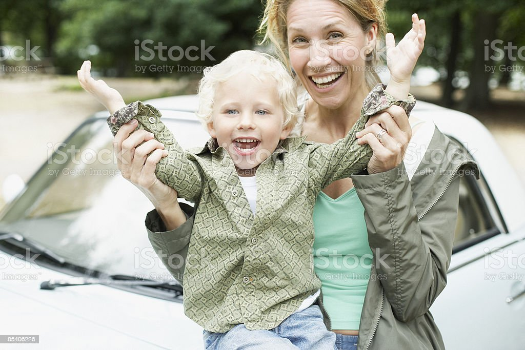 Mother and son playing near car royalty-free stock photo
