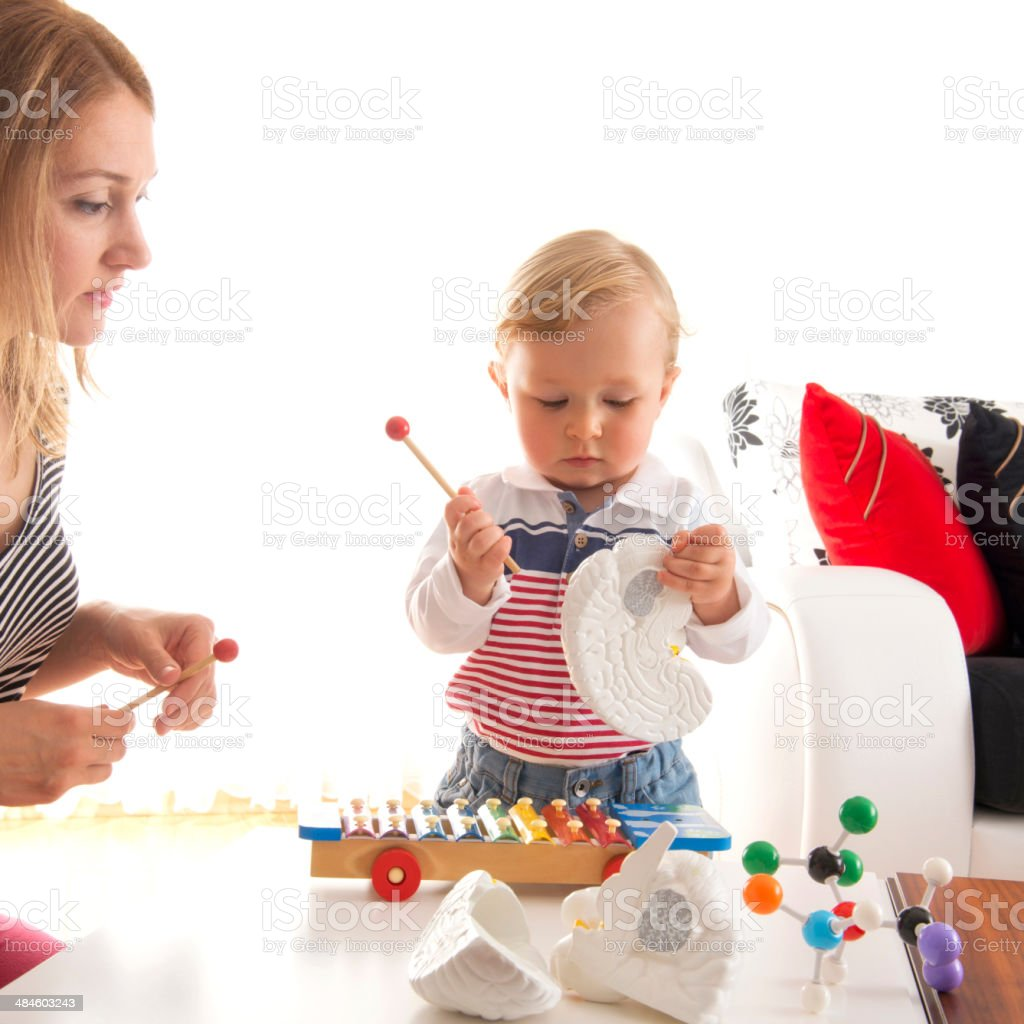 Mother and son playing stock photo