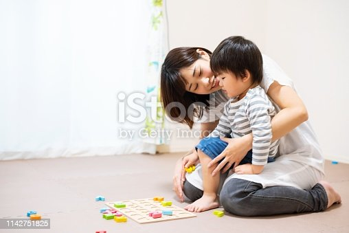 istock Mother and son play-learning together 1142751825