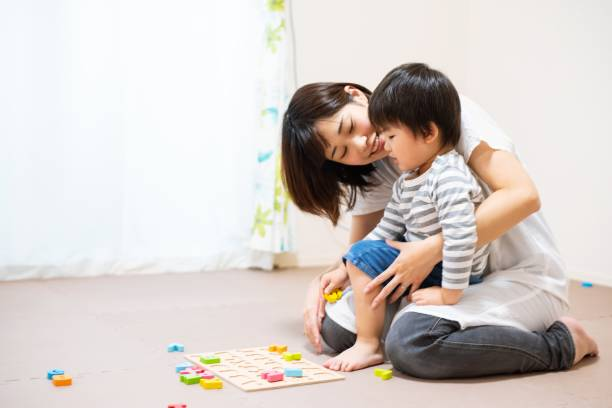 Mother and son play-learning together stock photo