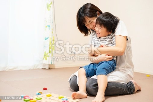 istock Mother and son play-learning together 1142751923