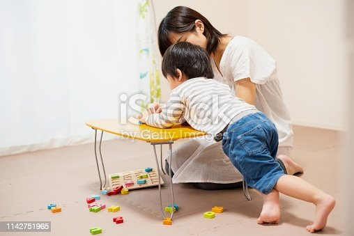 istock Mother and son play-learning together 1142751965