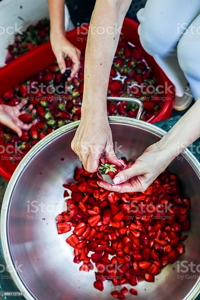Mother and Son preparing strawberries for making jam royalty-free stock photo