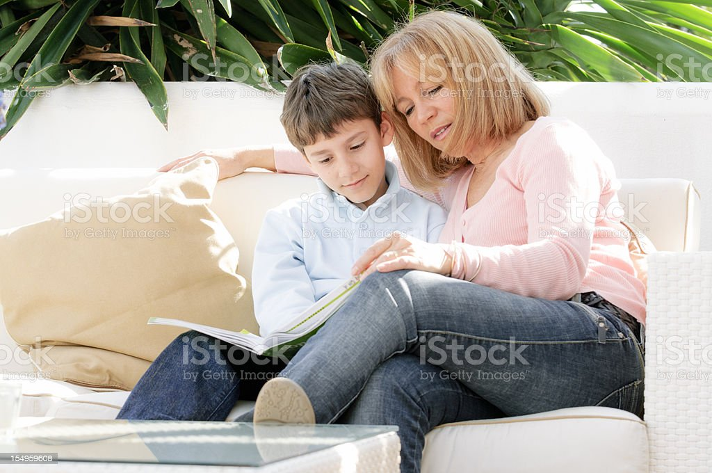 Mother and son reading a book royalty-free stock photo