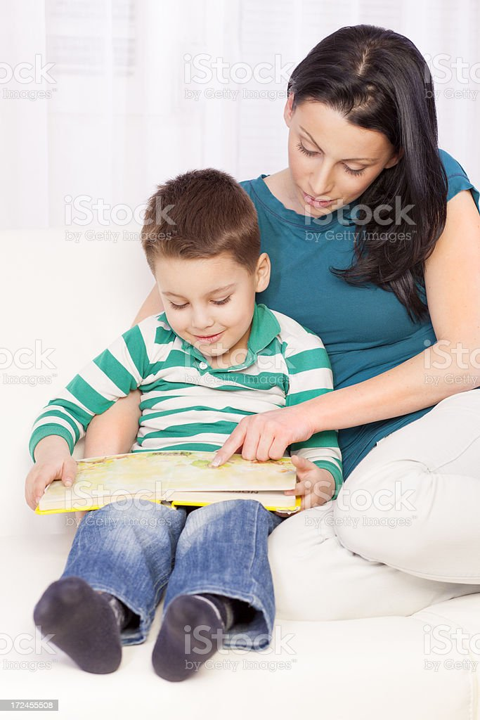Mother and son reading a story royalty-free stock photo