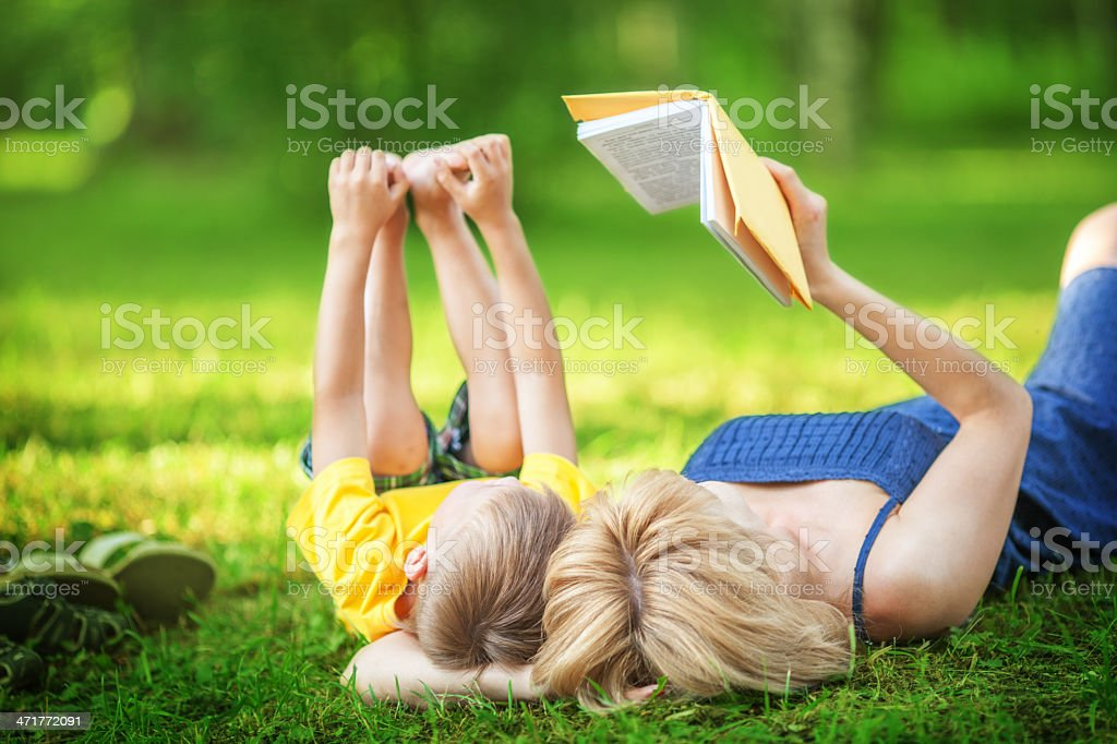 Mother and son reading book in the park royalty-free stock photo