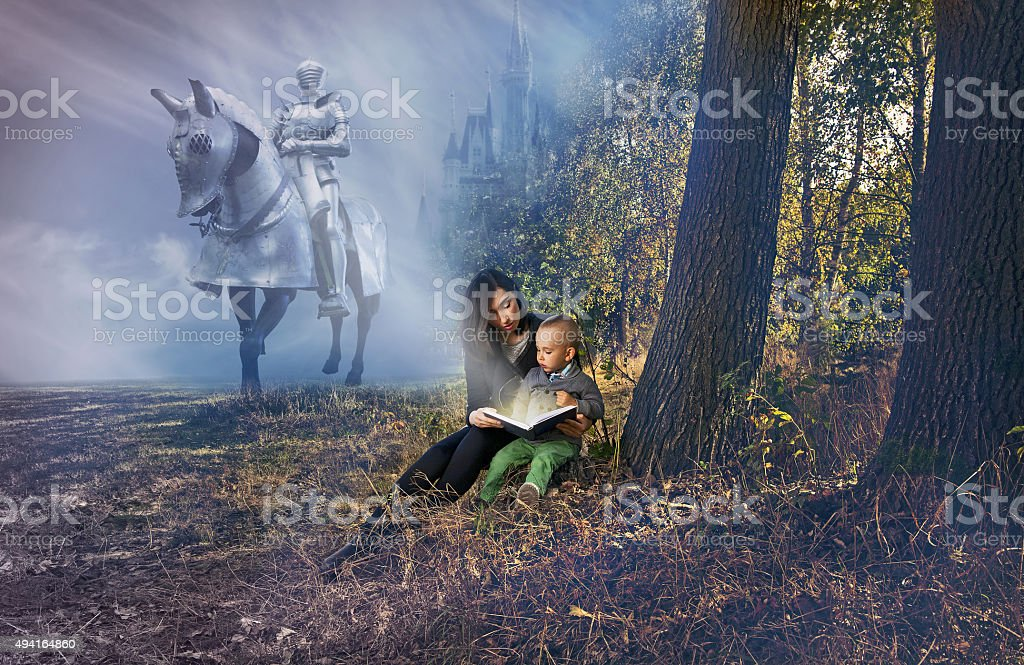 Mother and son reading fairy tales. stock photo